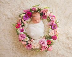Newborn shoot by @kiokreations and @jenniferkayephotography  Newborn with floral ring around her, flowers by www.kiokreations.com  Photo by http://athousandwordsgallery.com/ newborn surrounded by flowers, flower ring around baby, baby with flowers, baby in floral frame