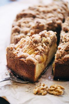 Cinnamon Apple Crumb Cake - A simple coffee cake topped with sliced apples and lots of crumbs. The perfect accompaniment to coffee of a crisp fall morning!
