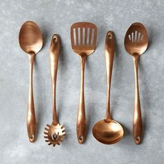 Copper kitchen utensils (would be stunning hung in front of teal or turquoise tiles).