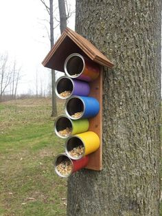 Just a picture- painted aluminum cans made into little bird feeders. We made this as a family today :) #birdhouses #birdhousetips