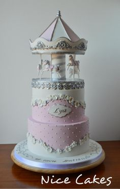 Pink and white Carousel Cake by Nice Cakes