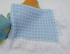 This crochet stitch has a lovely texture and makes a cozy warm blanket for a new baby. This is an easy crochet pattern suitable for beginners :) Let's Stitch. Tunisian Crochet, Crochet Stitches, Crochet Baby Blanket Free Pattern, Knitting Patterns, Crochet Patterns, Bobble Stitch, Granny Square Blanket, Crochet Videos, Baby Knitting