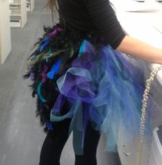 DIY peacock costume. Mixed color tutu, boa tail with random color feathers and peacock feathers added