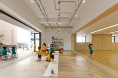 Hanazono Kindergarten designed by HIBINOSEKKEI + youji no shiro in Japan The building is left large open/unihibited on the ground floor to allow constant access outdoors wherever possible