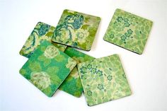 Mod podged coasters.... could probably make these with scrapbook paper to match the pillows in the living room!  These ones are from Amy Anderson on Mad in Crafts