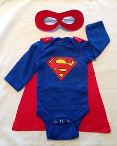 Superman or Superwoman Superhero Baby Onesie with Detachable Satin Cape and Reversible Mask, Super Hero Apparel or Costume. $29.00, via Etsy. (Cute - minus the mask!)