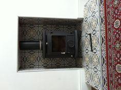 Wood burner. Nice tiling idea again.