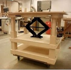 Adjustable Height Table by wintersnot -- Homemade adjustable height table constructed from Baltic birch and a scissors jack. http://www.homemadetools.net/homemade-adjustable-height-table-2