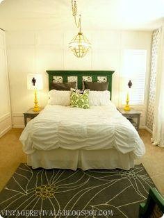 headboard is made from old door panel- painted, added molding, added fabric and nailhead trim to insets.  ALL of it = perfection!!!