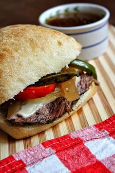 Slow Cooker French Dip Sandwich (with peppers, onions, and cheese) from Recipe Girl [via Slow Cooker from Scratch]