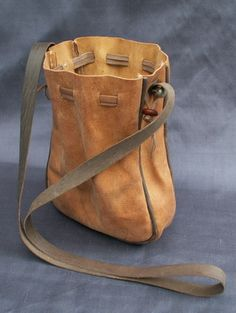 These purses are made from vegetable tanned goat skins that have been dyed using period dyes and they are made entirely by hand. The design for this purse comes from an illustration in Boccaccio's Decameron - 1430 and is a common style in the 14th and 15th centurys. It hangs from a leather cord and has a side gusset to give more room. It measures 7 x 7 inches (18 x 18 cms) when open. £30
