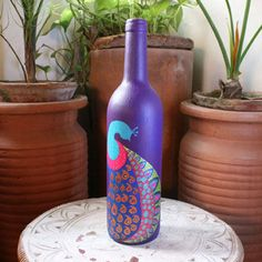 Shopo | Product from Baatli Blues Shop | Upcycled painted Wine Bottle with vibrant Peacock motif - purple