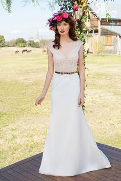 """Fishtail Wedding Dress of soft satin and sheer bodice of tulle and beading. Illusion Neckline, plunging front and pack with gold belt feature. Bridal Gown Roz la Kelin """"Athena"""" by Pearl collection."""