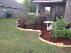 Edging idea! Staggered wood planks