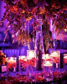 Stunning #centerpiece at this blue #uplighting reception. Photo via #stevieramosphotography #bridalguide