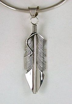 Authentic Native American sterling silver Feather Pendant by Navajo Chris Charley