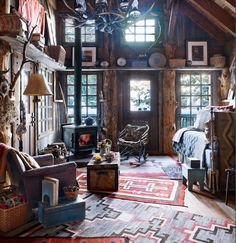 Mountain escape: Navajo weavings from the early 1900s and a warm fire set the mood in Buffy Birrittella's Sundance, Utah home featured in Elle Decor