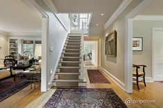 Traditional Staircase with Crown molding, Floating staircase, High ceiling, Hardwood floors