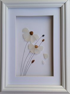 Sea Glass Flowers, Sea Glass Art, Daisies, Coastal Wall Decor, Made in Cornwall Flowers created from the little bits of flotsam and jetsam I take home from the beach in my pocket. Nuggets of perfectly petal shaped, ocean smoothed sea glass make up these flowers blowing in the wind.
