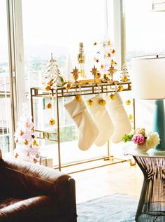 Use existing pieces to pull together your holiday decor, like a gold bar cart for your stockings // via Emily Henderson, Photo by Jayme Burrows