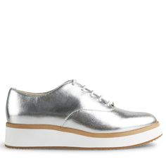 Crafted from supple silver leather, these platforms are some serious urban edge. Combining the support and white sole silhouette of a sneaker with the clean leather lace up upper of a brogue, Milas are a style stand out for any winter wardrobe.  Leather