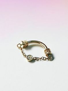 Diamond Septum Spinner | Gold septum or cartridge ring with dangling chain and diamond accent.   *By Venus by Maria Tash