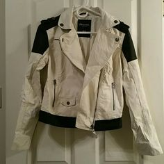 NWOT!! Black and White Zippered Jacket!! BRAND NEW!! NEVER WORN!! Black and white faux leather and Uber soft Zippered Jacket!! 3 zippered pockets, one buttoned pocket and front zip!  Really is so cute! Bought two of these and am keeping the one in black. Aeropostale Jackets & Coats Utility Jackets