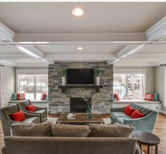 Tray ceilings and stone fireplace open kitchen family room concept