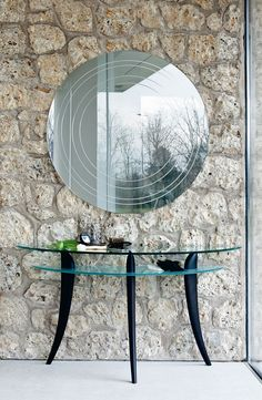Ring is a modern wall mirror in mirrored glass with circular bevels. It was designed by Emanuele Zenere for Cattelan Italia.