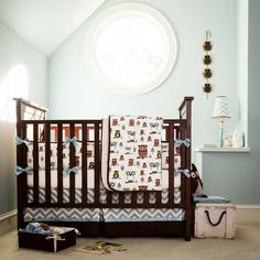 Baby Nursery, Charming Carousel Design Bedding For Your Precious Little Baby: Dazzling Dark Brown Crib With Retro Owls And Blue Chevron Carousel Bedding