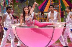Bollywood actor Elli Avram performs during an event ahead of Holi festival, in Mumbai.
