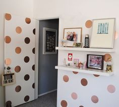 Embrace oversize metallics by covering your walls and door with gold polka dots.