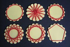 Spirelli-string art--very easy and so cool!  Materials needed: cardstock, a scalloped circle punch (we used Fiskars' Seal of Approval Squeeze Punch), some sort of string (thread, yarn, embroidery floss, etc), tape, and scissors.