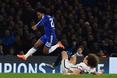 Chelsea's Brazilian midfielder Willian leaps a challenge from Paris Saint-Germain's Brazilian defender David Luiz during the UEFA Champions League round of 16 second leg football match between Chelsea and Paris Saint-Germain at Stamford Bridge in London on March 9, 2016.