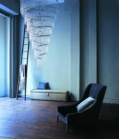 Spiral light.  (make smaller version out of lightweight coiled metal tubeing from the hardware store, add crossbar and light at the top -- then hang from a hook in the ceiling, in a corner, above a reading chair?)  ps: add rings to tubeing, then attach whatever you want to the rings.