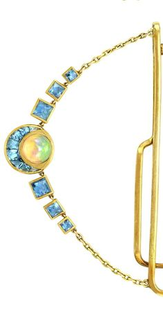 Gentleman's Gold, Opal and Aquamarine Jewelry, Seaman Schepps.  The tie clip supporting a swag centering one round opal flanked by 6 square-cut aquamarines, all the opals flanked by aquamarine-set curved panels, signed Seaman Schepps, circa 1940,