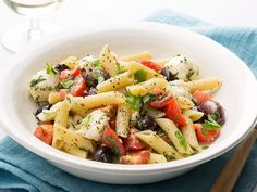Get this all-star, easy-to-follow Penne with Baby Mozzarella, Tomatoes, and Herbs recipe from Food Network Kitchen