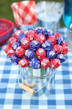 Patriotic Lollipop Centerpiece: Serving double duty, this of July table topper tastes as delicious as it looks. Click through to discover more quick and easy DIY decorations to make for of July. Fourth Of July Decor, 4th Of July Desserts, 4th Of July Celebration, 4th Of July Decorations, 4th Of July Party, 4th Of July Ideas, Outdoor Decorations, Diy Decoration, Holiday Desserts