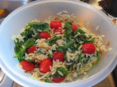 * Lemon Orzo with Pine Nuts 1/2 lb. orzo (about 1 generous cup) 1/2 cup pine nuts, toasted 1/2 pint cherry or grape tomatoes, whole 1 large handful baby spinach leaves, roughly chopped 1/2 lemon, reserve the other half in case you need it Olive oil (about 1/3 cup) Kosher salt and pepper, to taste