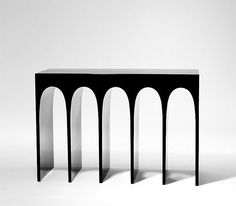 The Passage Console Table in lacquered-aluminum by Hervé Van der Straeten mimics the arches of the Roman Colosseum. #ArchPorn #TheDesignRelease