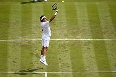 Roger Federer goes up for a volley
