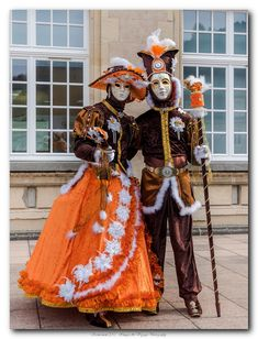 Carnival of Venice costumes of orange and brown ~ 2015