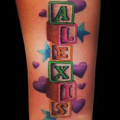 Name tattoo. Alexis, spelled with blocks. #nametat
