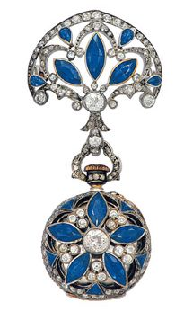 An Antique Sapphire and Diamond Lapel Watch, circa 1890 Decorated with sapphires and old-cut diamonds, the circular case of floral design reversing to an openface watch with white dial and blue Arabic numerals, manual winding movement, detachable from a brooch of palmette motif, mounted in silver and 18k gold .