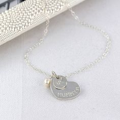Gorgeous silver necklace with personalised double heart charm, representing mummy and little one, and semi-precious birthstone. Choose your gemstone by birthstone or simply your favourite colour (see below for birthstones and starsigns). Your necklace is handmade to order by Emma. It will be wrapped in tissue and beautifully presented in our signature velvet pouch ready to give as a gift. Please note engravings are handstamped, not machine engraved, and wont be perfectly straight making each…