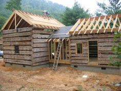 A restored antique log cabin - building progress 2006