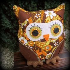 for the cushions,this cute owl will certainly make the sofa feel  more cosy....