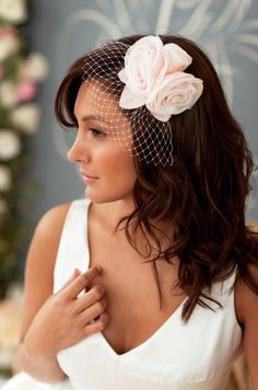Soft waves with birdcage veil and flowers..