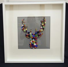Stags head with multi coloured buttons.