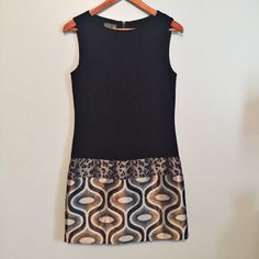 """Muse sheath dress Great condition.  Fits the to size.  Great stretch with metallic pattern hem.  34"""" from shoulder to hem, 17"""" bust.   No trades. Reasonable offers welcome 🍾Note: 20% off bundles of 2+ items in my closet! Muse Dresses"""